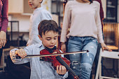 little boy violin lessons music school