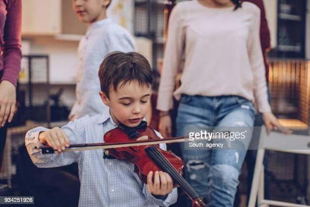 Little boy playing violin