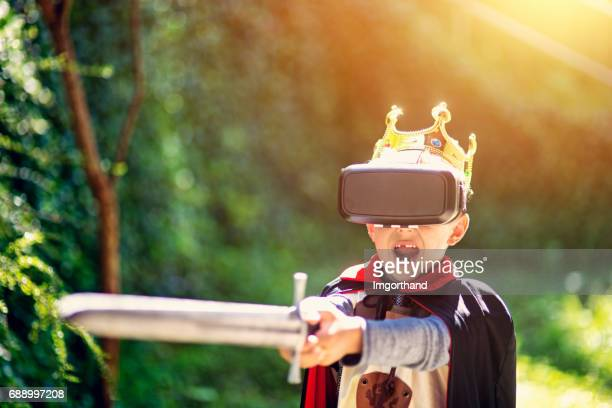 little boy playing virtual reality games - reality kings stock pictures, royalty-free photos & images