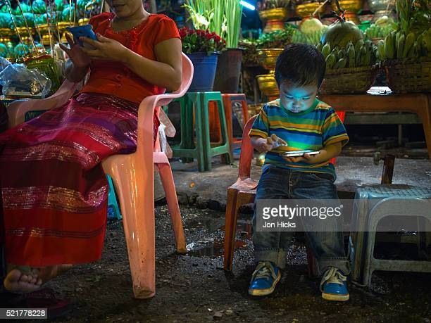 Little boy playing with a smart phone in Yangon