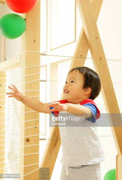 Little boy playing with balloon