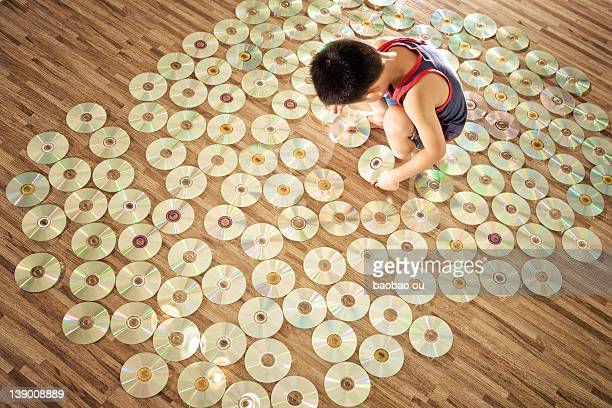 Little boy playing with disks