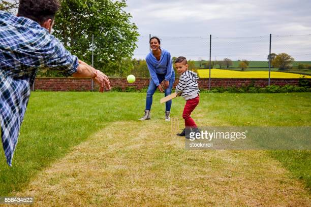 little boy playing with his parents - sport of cricket stock pictures, royalty-free photos & images