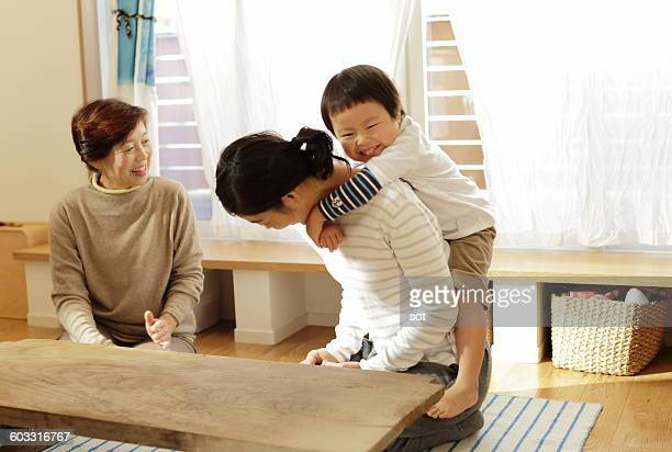 Little boy playing with mother and grandmother