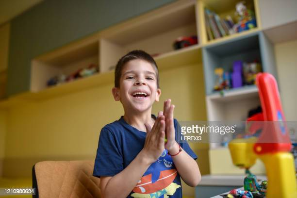 little boy playing with plasticine - lerexis stock pictures, royalty-free photos & images