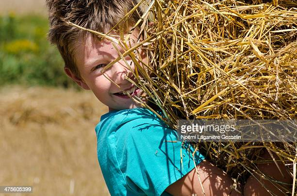 Little boy playing with straw