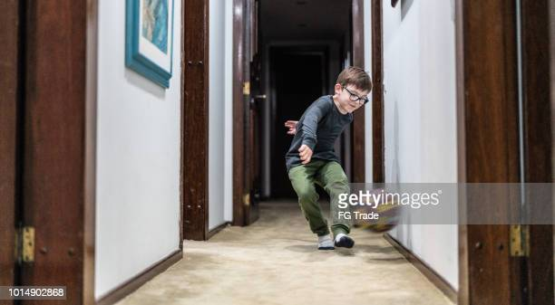 little boy playing with the ball at home - kicking stock pictures, royalty-free photos & images