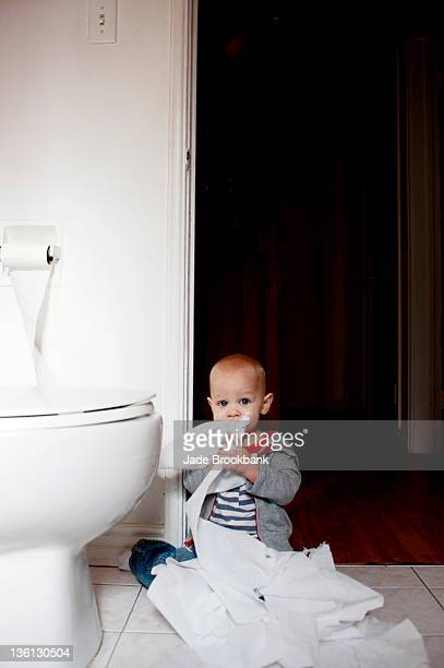 little boy playing with toilet paper - funny toilet paper imagens e fotografias de stock