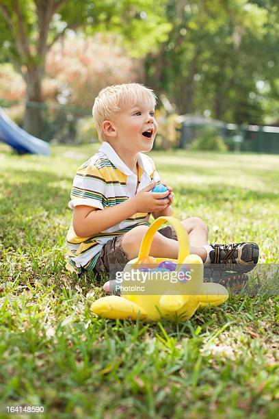 Little Boy Playing With Toy Basket At Park