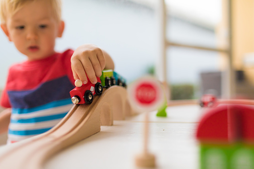 Little boy playing with toy train. 1164225032