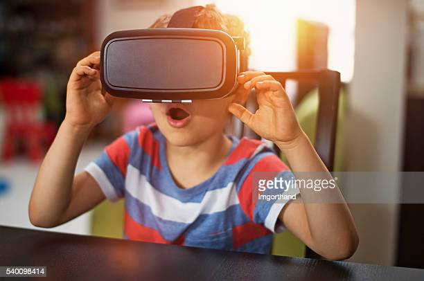 Little boy playing with virtual reality headset