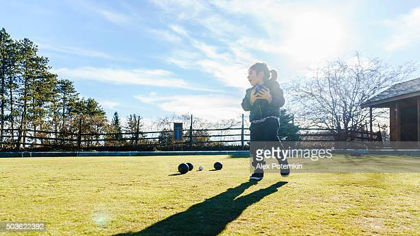 Little boy plays bowls at the lawn