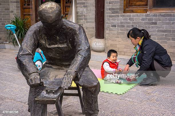 A little boy plays on the plastic cushions on the street In China trafficking of children Stayathome children and Children abuse are the biggest...