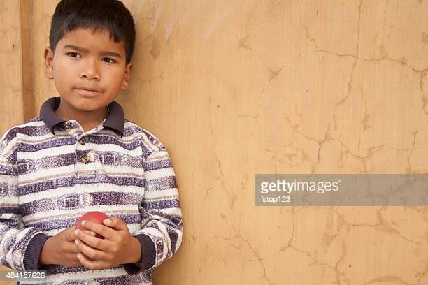 little boy plays with small ball in india city streets. - utvecklingsland bildbanksfoton och bilder