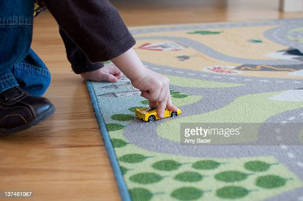 little boy plays with yellow car - toy car stock pictures, royalty-free photos & images