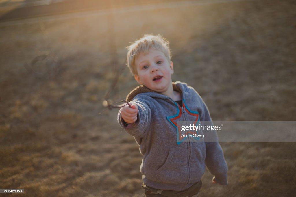 Little Boy Pointing Big Stick : Stock Photo
