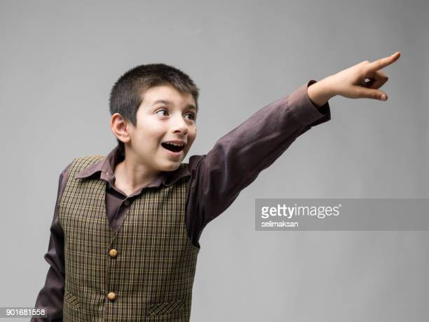 little boy pointing forward - human finger stock photos and pictures