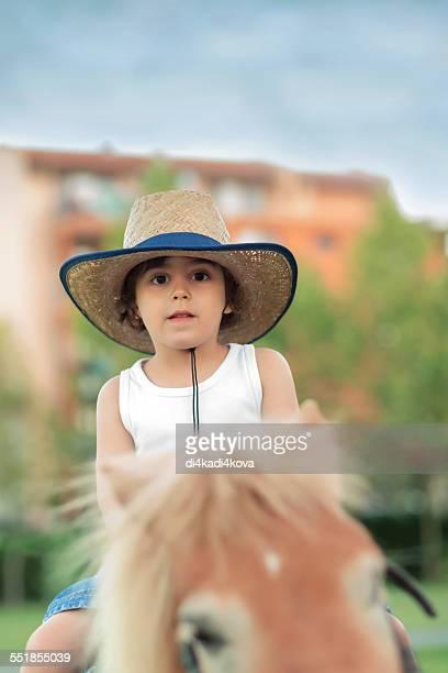 little boy pony ride - pony play bildbanksfoton och bilder