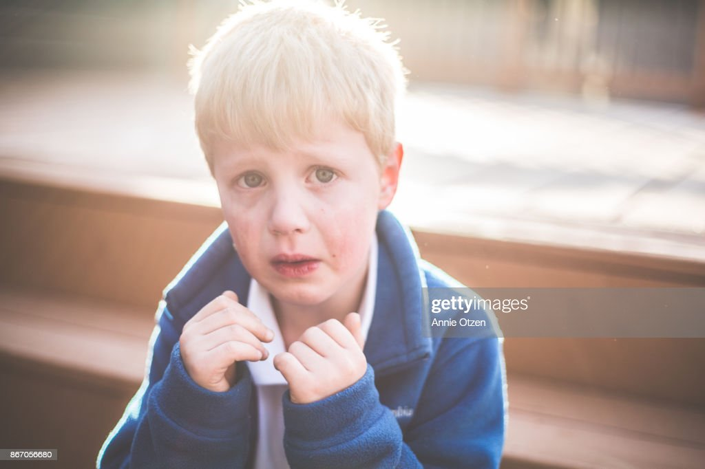 Little boy pouting and crying : Stock Photo