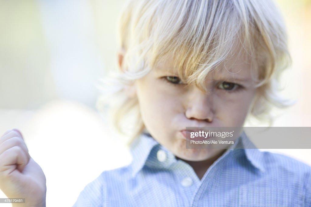Little boy pouting : Stock Photo