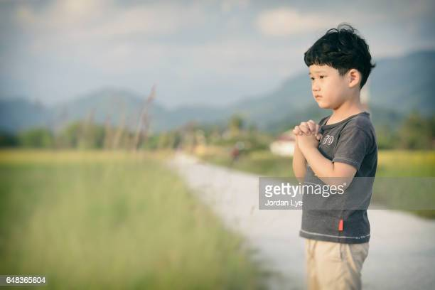little boy praying outdoor - place of worship stock pictures, royalty-free photos & images