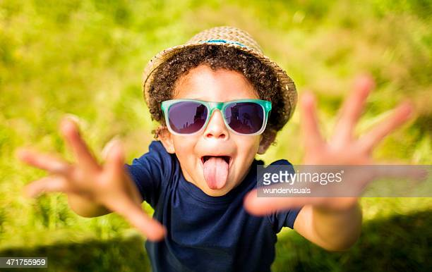 Little boy pulling a face with arms outstreched