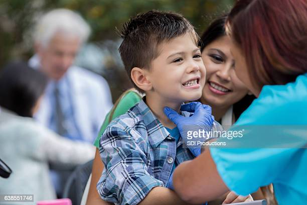 Little boy receives treatment at outdoor free clinic