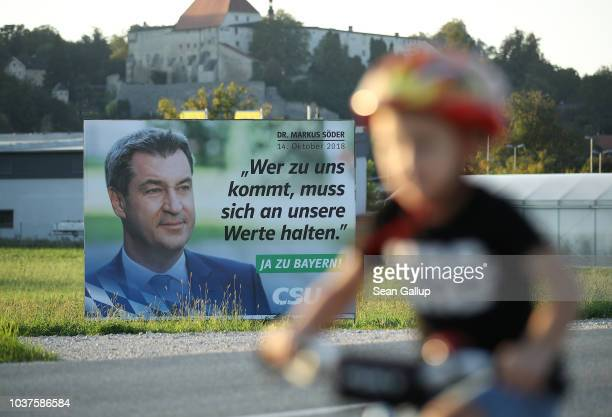 An election campaign billboard of the Bavarian Social Union showing Bavarian Governor and CSU lead candidate Markus Soeder reads 'We're holding...