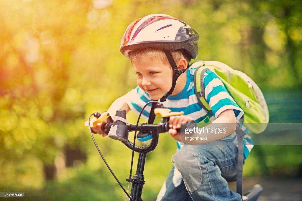 Little boy riding a bike : Stock Photo
