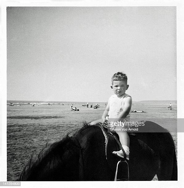 little boy riding pony on beach - 1961 stock pictures, royalty-free photos & images
