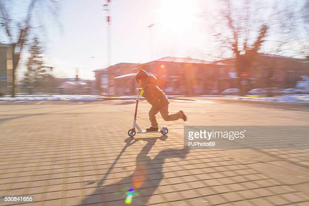 little boy riding push scooter - pjphoto69 stock pictures, royalty-free photos & images