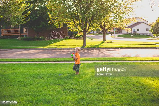 Little Boy running Across Yard