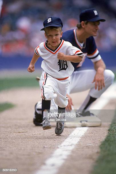 A little boy runs to home plate during an annual Father and Son Game in Detroit Michigan