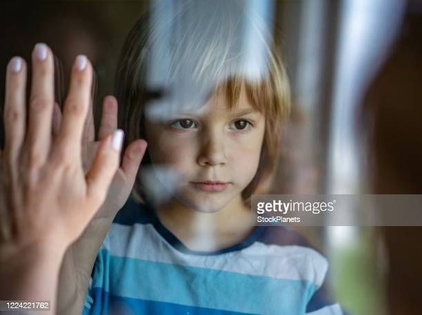 little boy says goodbye before mom goes on work - separation stock pictures, royalty-free photos & images