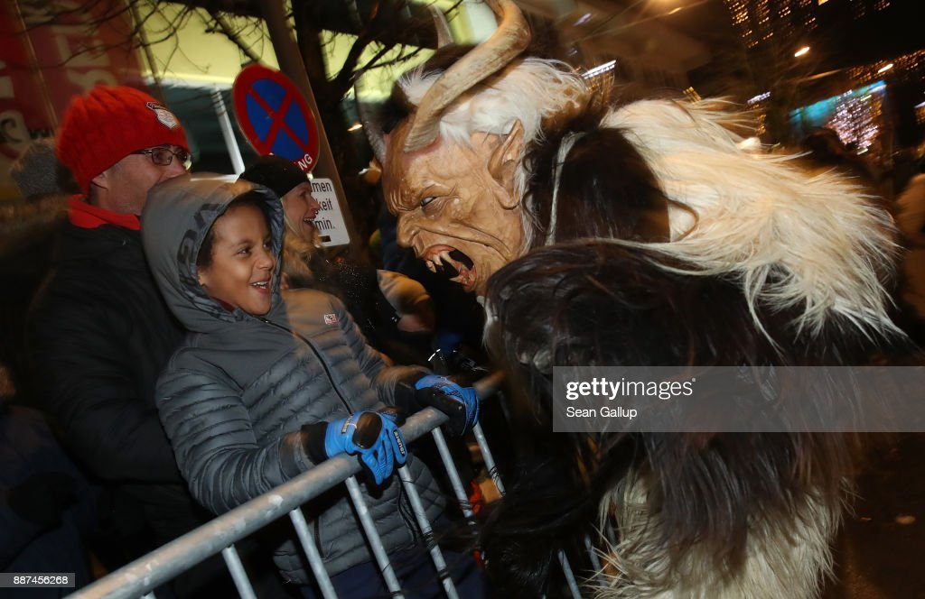 A little boy seems unfazed while confronting a devilish Krampus creature during the annual Krampus parade on Saint Nicholas Day on December 6, 2017 in Sankt Johann im Pongau, Austria. Several hundred Krampus creatures from the region took part in this year's Sankt Johann parade. Krampus traditionally accompanies Saint Nicholas and angels in a house to house procession to reward children who have been good and warn those who have not, though in recent decades Krampus parades have become an intrinsic part of local folklore and take place throughout the end of November and into the first half of December in the alpine regions of Germany, Austria and Italy. Krampus usually wears large cowbells on his back that he rings by shaking his hips to ward off the evil spirits of winter. He also carries a switch made of branches or animal hair that he uses to whip bystanders.