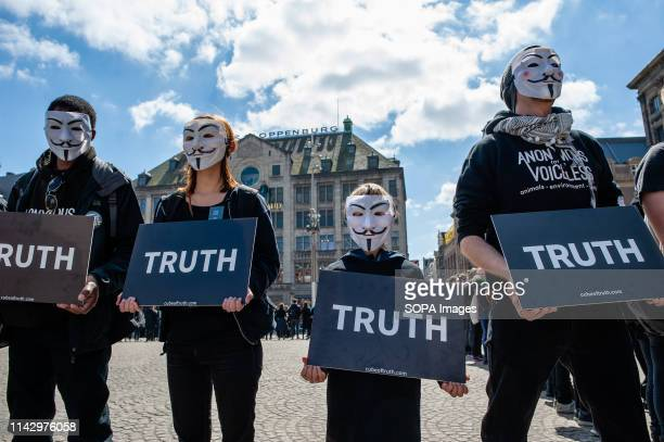 A little boy seen wearing a Guy Fawkes mask while holding a placard during the demonstration Hundreds of activists gathered at the Dam square in the...