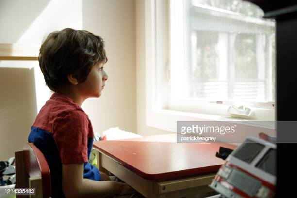 little boy self-isolation at home - sad child stock pictures, royalty-free photos & images