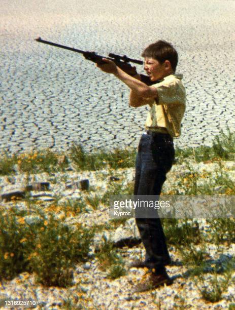 little boy shooting an air-rifle - london, england, 1972 - shooting crime stock pictures, royalty-free photos & images
