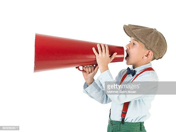 Little Boy Shouting Via Old Fashioned Megaphone