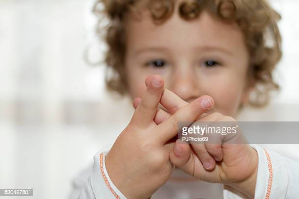 Little boy showing Hashtag sign