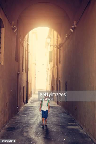 Little boy sightseeing italian town