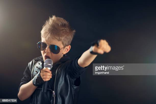 Little boy singing rock