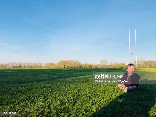 little boy sitting alone on hackney marshes in london - one baby boy only stock pictures, royalty-free photos & images