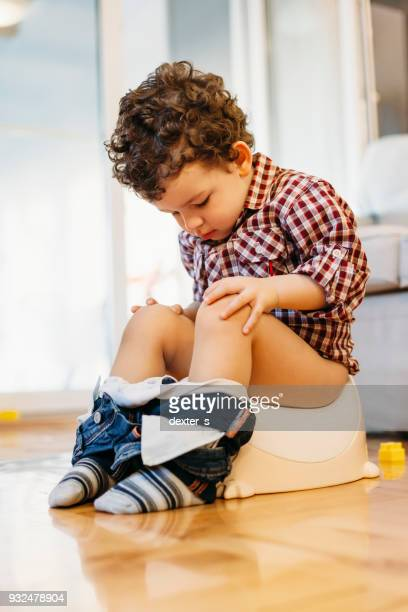 little boy sitting on potty - kids peeing stock pictures, royalty-free photos & images