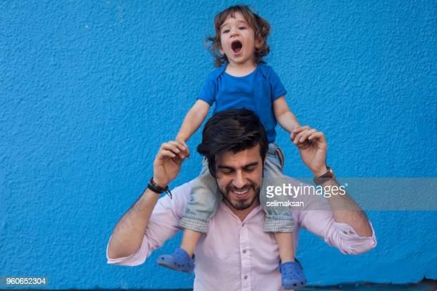Little Boy Sitting On Shoulders