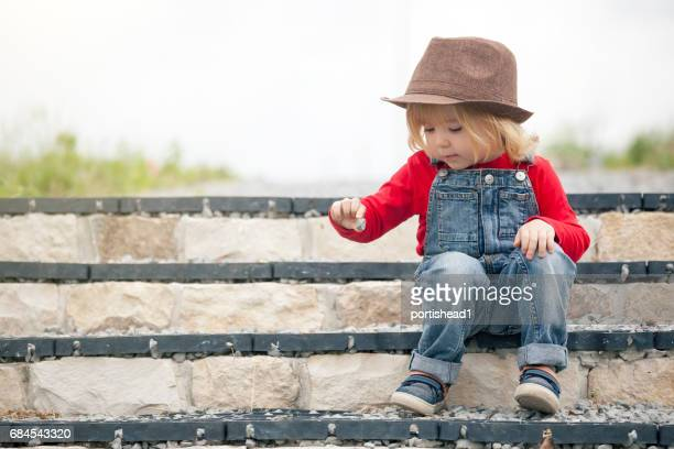 Little boy sitting on stairs