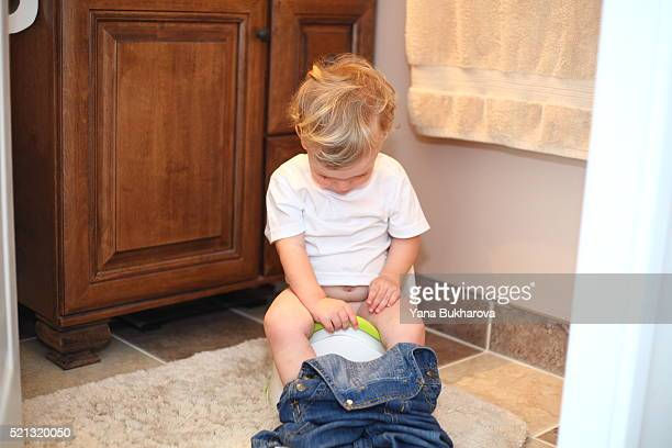 little boy sitting on the potty - kids peeing stock pictures, royalty-free photos & images