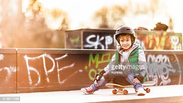Little boy skateboarding