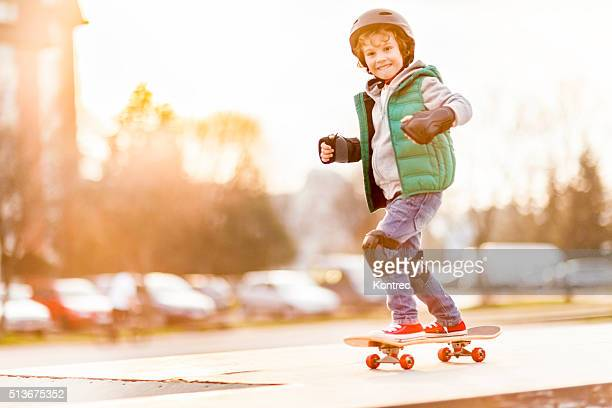 little boy skateboarding - skating stock photos and pictures