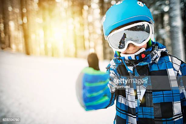 little boy skiing in snowy forest on sunny winter day - wintersport stock-fotos und bilder